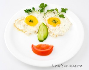 fried eggs with vegetables, served for kids